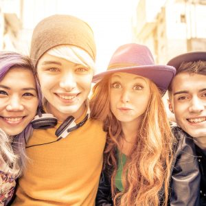Close up of Four youth adults smiling