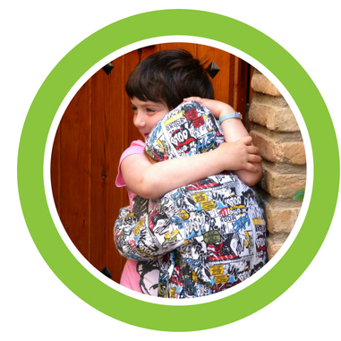 Picture of two children hugging.