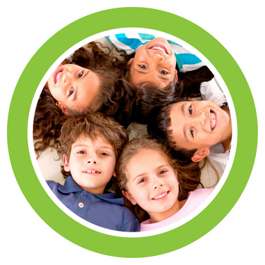 Picture of kids' faces facing upwards in a circle